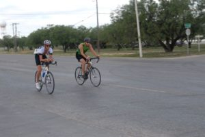 two bicyclists riding their bikes together
